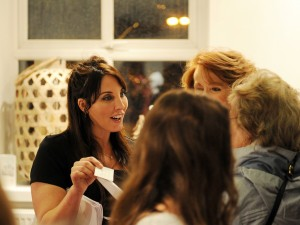 Andrea chats with clients at Springs Beauty relaunch